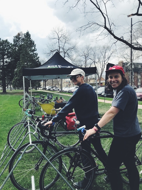 Two bikers posing with their bikes at bike valet